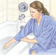 Woman preparing bath water